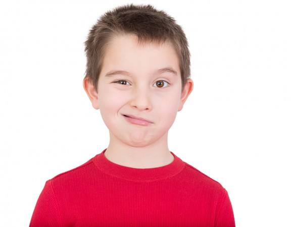 Cute Young Boy Winking At The Camera