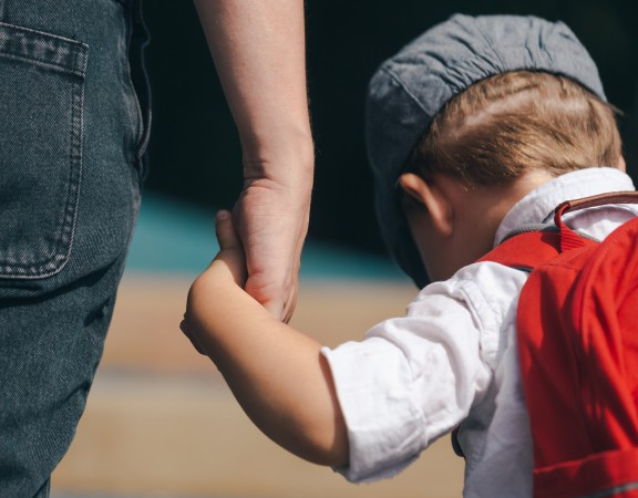 little-boy-holding-moms-hand
